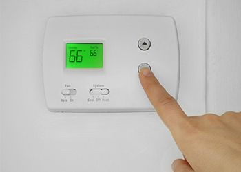 Thermostat Installations & Service | Alien Air Conditioning & Heating  - thermostat-pressing-button